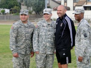 Matrix South Bay Director of Coaching Memo Medina shares a moment with Army National Guard members.